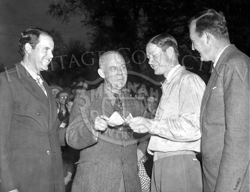 Byron Nelson, youthful pro from Reading, PA., who staged sensational finish to win the Augusta National Golf Tourney, is shown receiving his $1,500 check from Grantland Rice, Ralph Guldahl (left) and Ed Dudley, who finished second and third respectively.