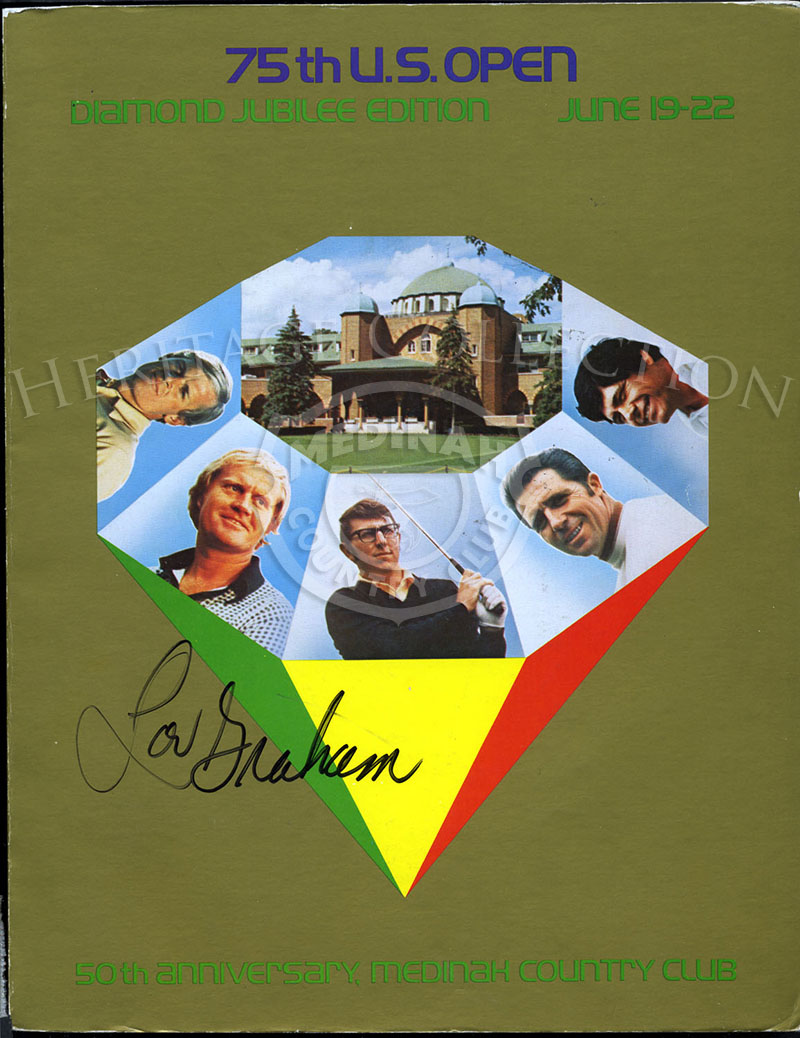 A copy of the 75th U.S. Open Diamond Jubilee magazine features an autograph by tournament winner Lou Graham on the cover.