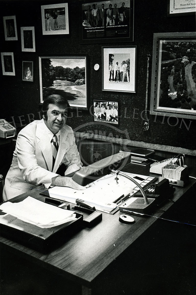 John Marschall, Medinah Head Professional, sitting in his office.