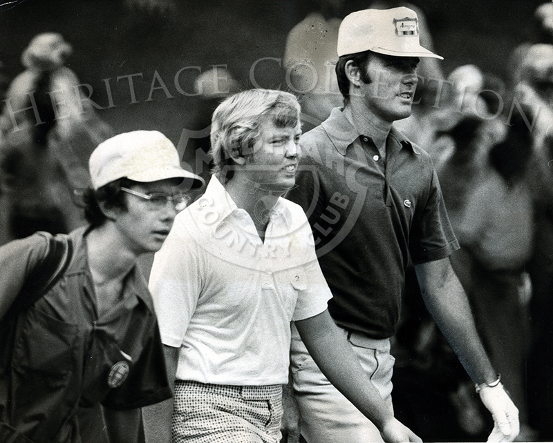 Lou Graham (right), striding from first tee in Monday's U.S. Open playoff at Medinah Country Club, defeated John Mahaffey (center) by two strokes. The Tennessee pro scored an even par 71, while Mahaffey did it in 73 strokes.