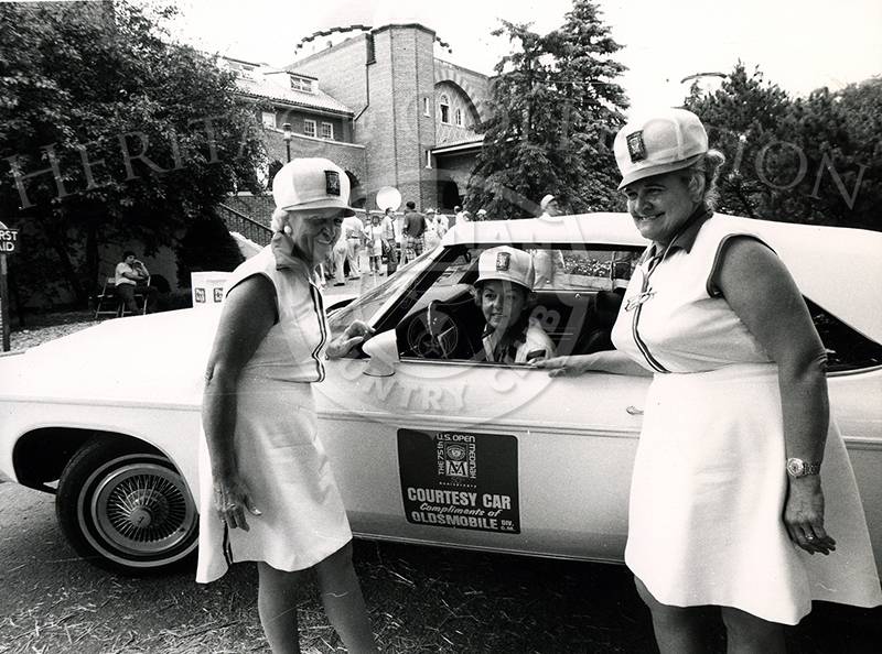 Three Medinah ladies with one of the Oldsmobile Courtesy Car.