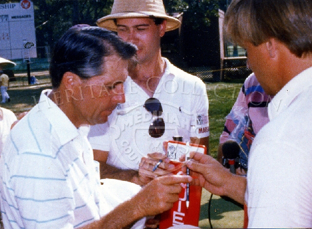 Gary Player, left, receives a fan's pen to sign an autograph during the Ninth U.S. Senior Open Championship. Player went on to win the Playoff Round on August 9th, defeating Bob Charles by one stroke.