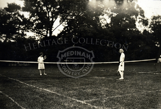 Photo of two women on tennis court.