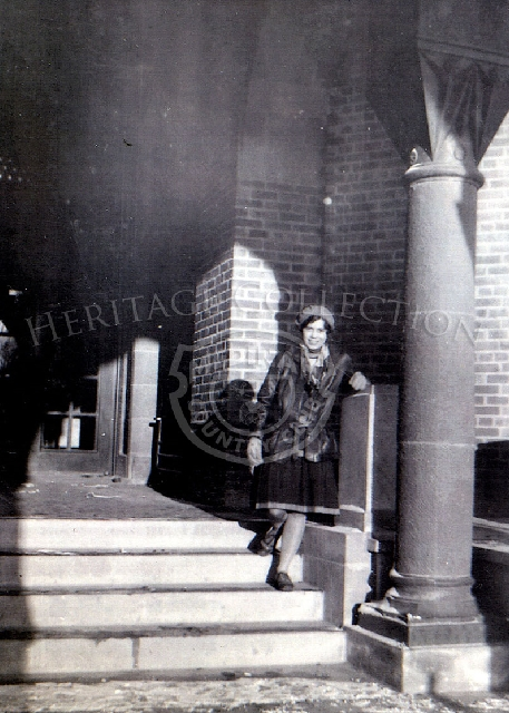 Edyth C. Schmidt, wife of clubhouse architect Ernest Schmid, on clubhouse front steps, Jan 1, 1929.