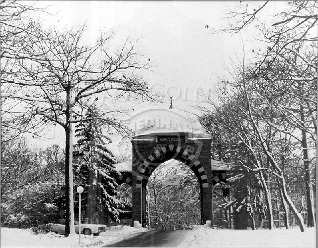 Front Gate Tower in winter with 1971 Lincoln Continental park on the side.