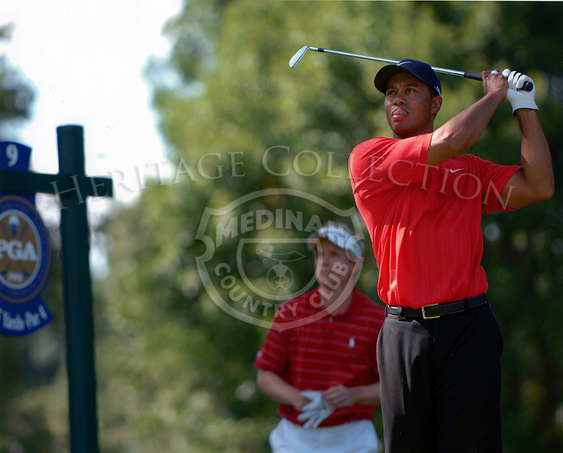 Tiger Woods tees off the 9th hole, fellow competitor Luke Donald looks on. August 2006.
