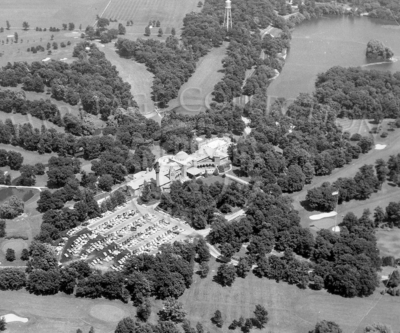 Aerial view of MCC. clubhouse in the middle. Lake Kadijah upper right.