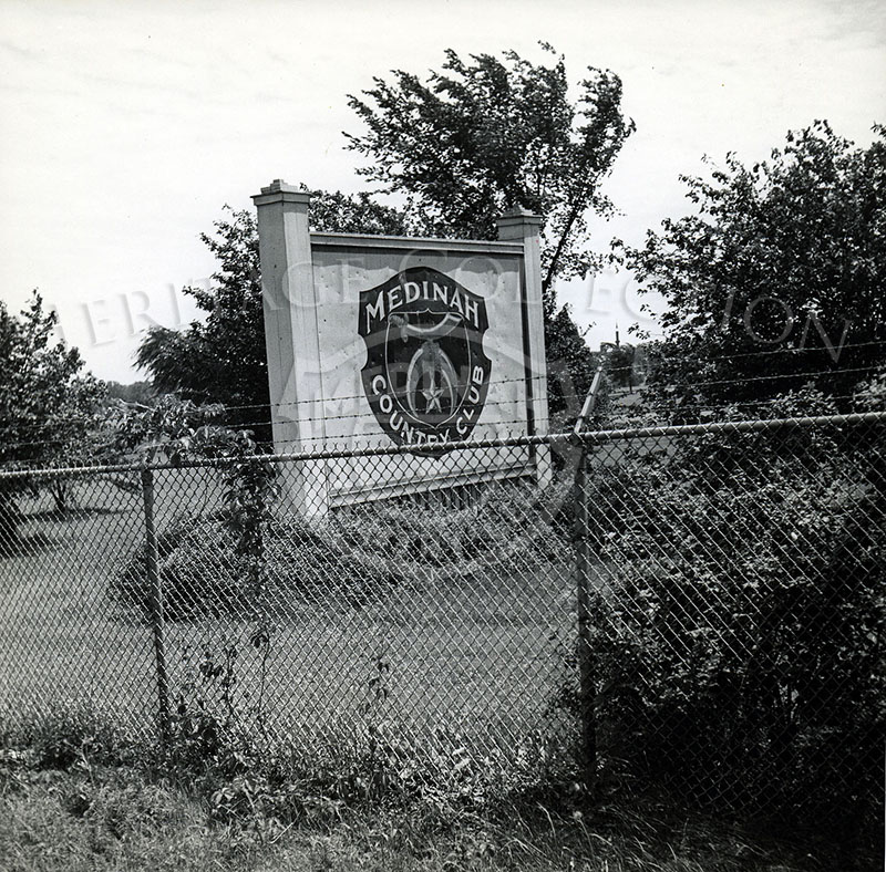 A Medinah Country Club sign behind fence in 1944.