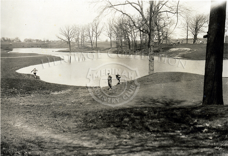 Circa 1920s black and white photo of 9th hole, course No. 1 and Meecham Creek. Three golfers are in the scene. Same scene as photo ID 85425.