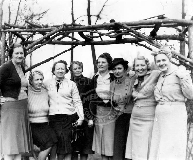 Eight women in a group photo.