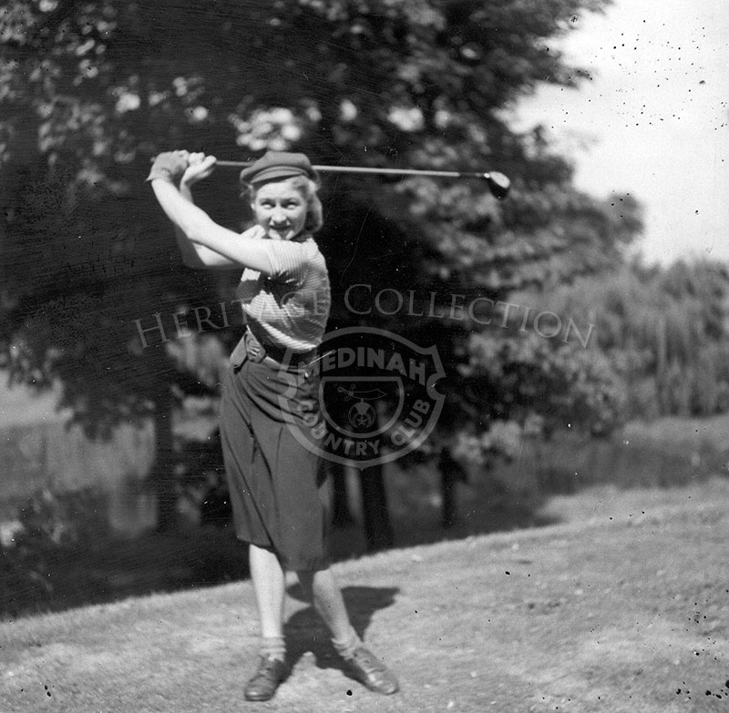 Adeline Potter swinging golf club.