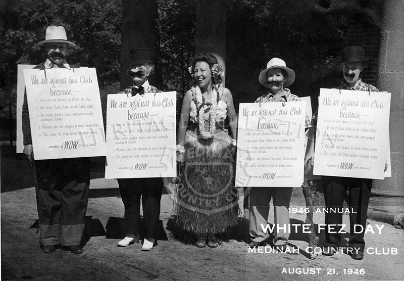 Annual White Fez Day Aug 21, 1946. Four people with signs