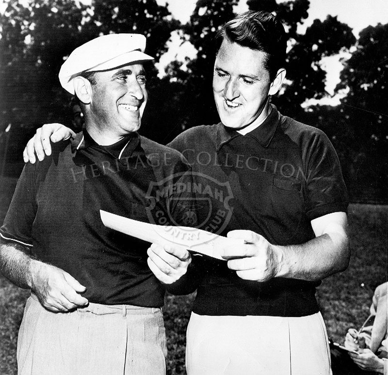 Golf Pro Herman Barron (left) of White Plains, NY, shows his one under par 70 score to Lewis Worsham after Barron took an early lead at the 49th U.S.Open.