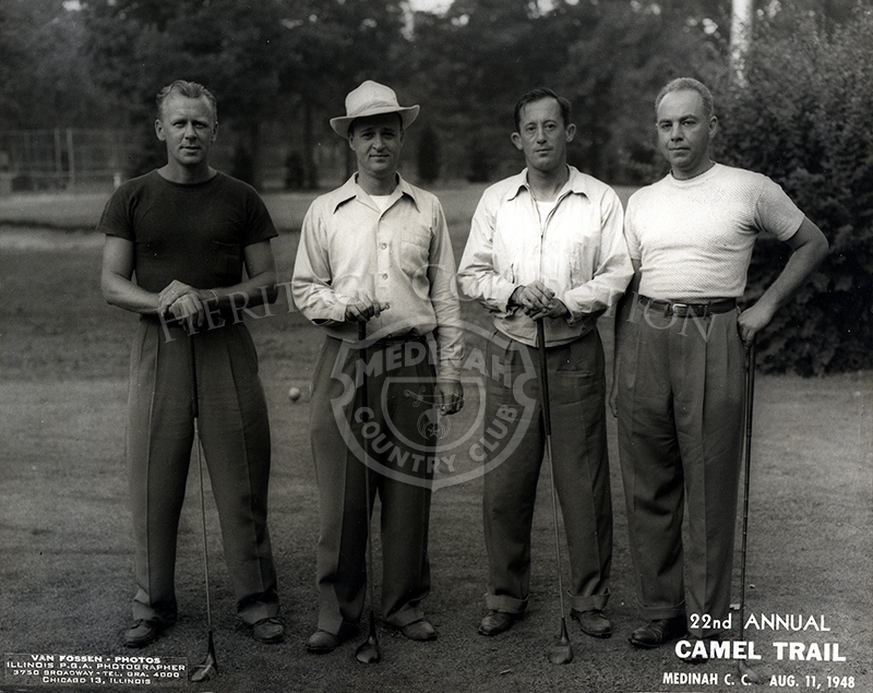 Four golfers posed during the 22nd Annual Camel Trail Day, held August 11, 1948.