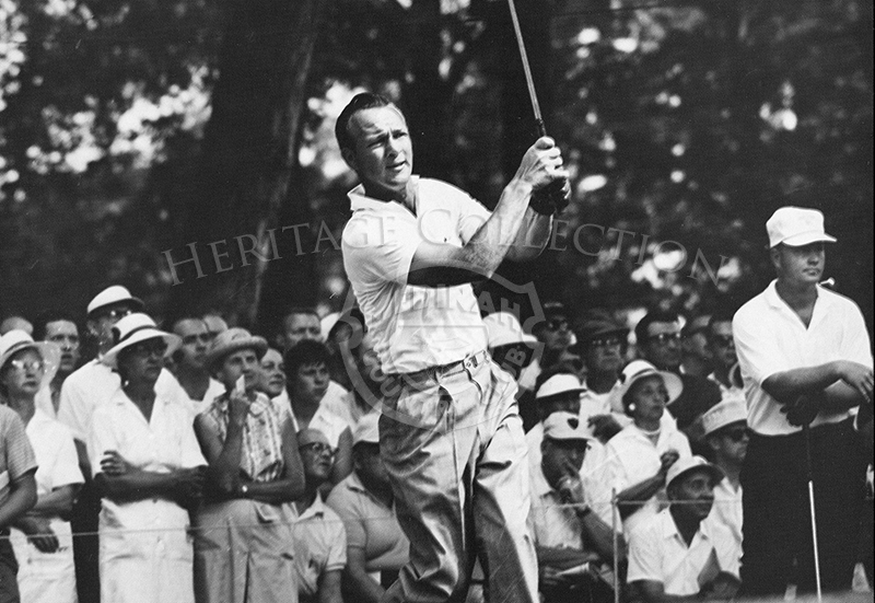 Arnold Palmer in play, and Jack Nicklaus leaning on golf club during the 63rd Western Open in 1966. This photo appeared in the 1983 Event Calendar from Medinah Country Club.