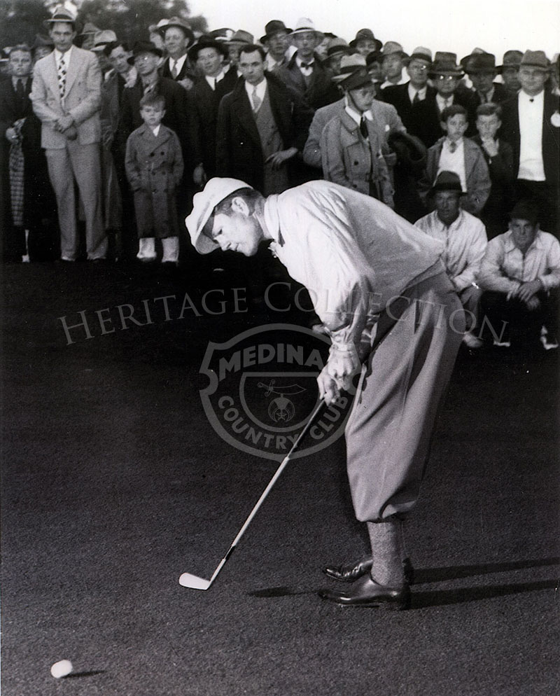 Byron Nelson doing the last putt at 4th annual Masters, Georgia. Blk/wht April 6, 1937.