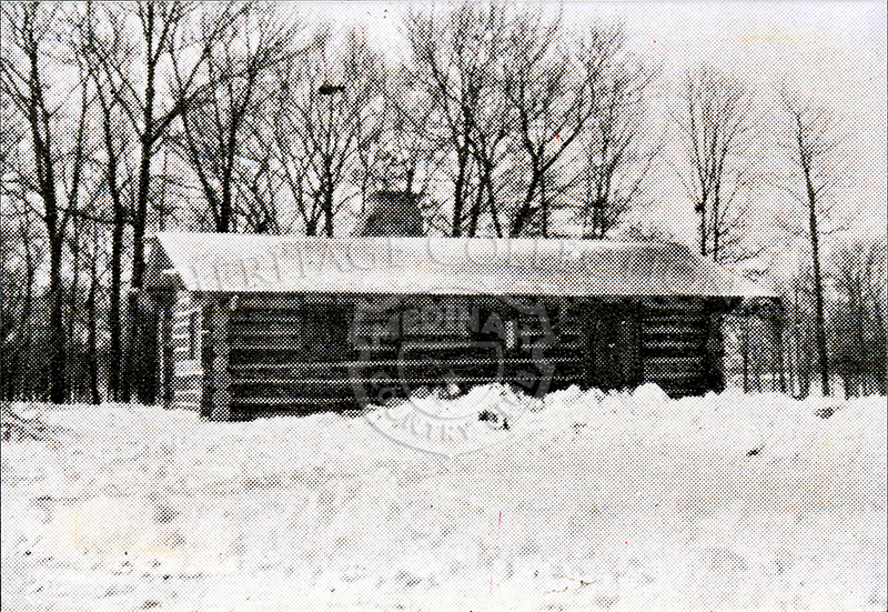 Photo of the log cabin near the ski jump on Medinah Country Club property, Both are long gone.