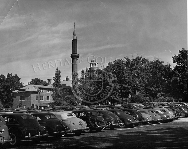 Parking lot seen with back of cars, circa 1940s.