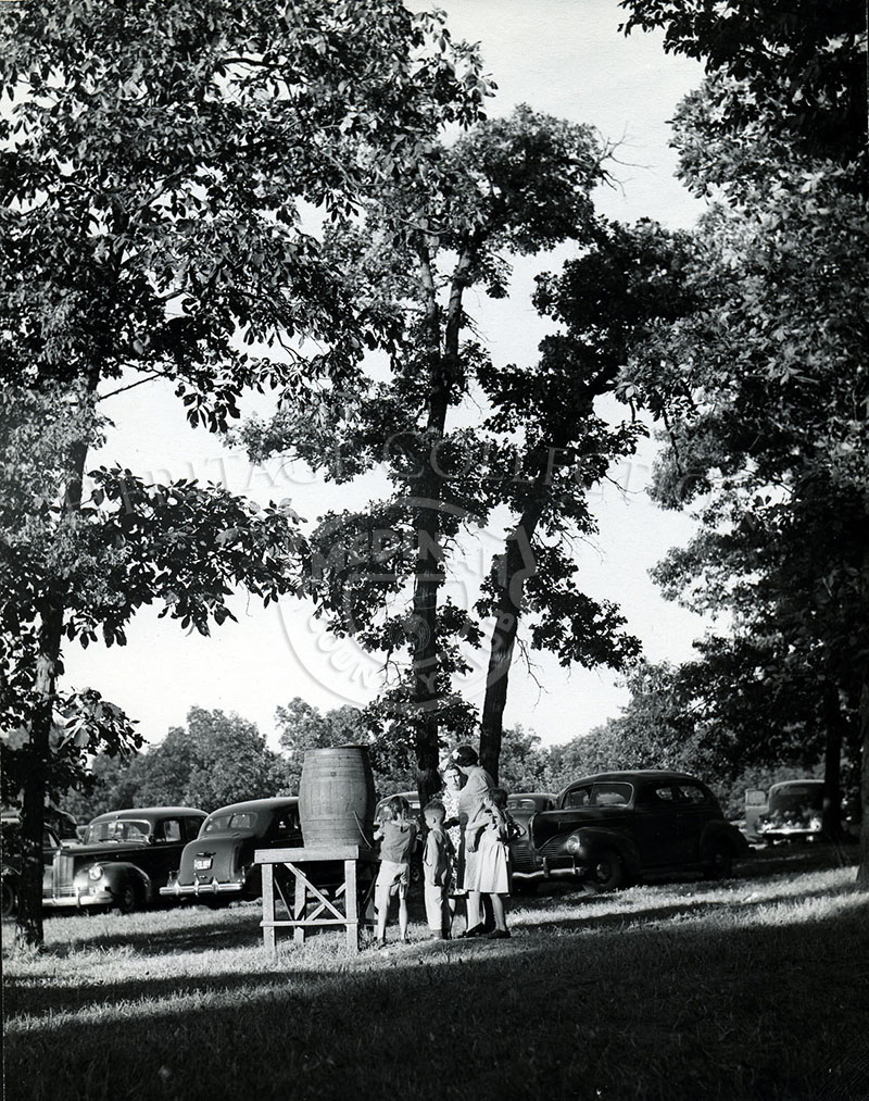 Shriner Picnic MCC Aug 13, 1944. Oasis with water barrel.