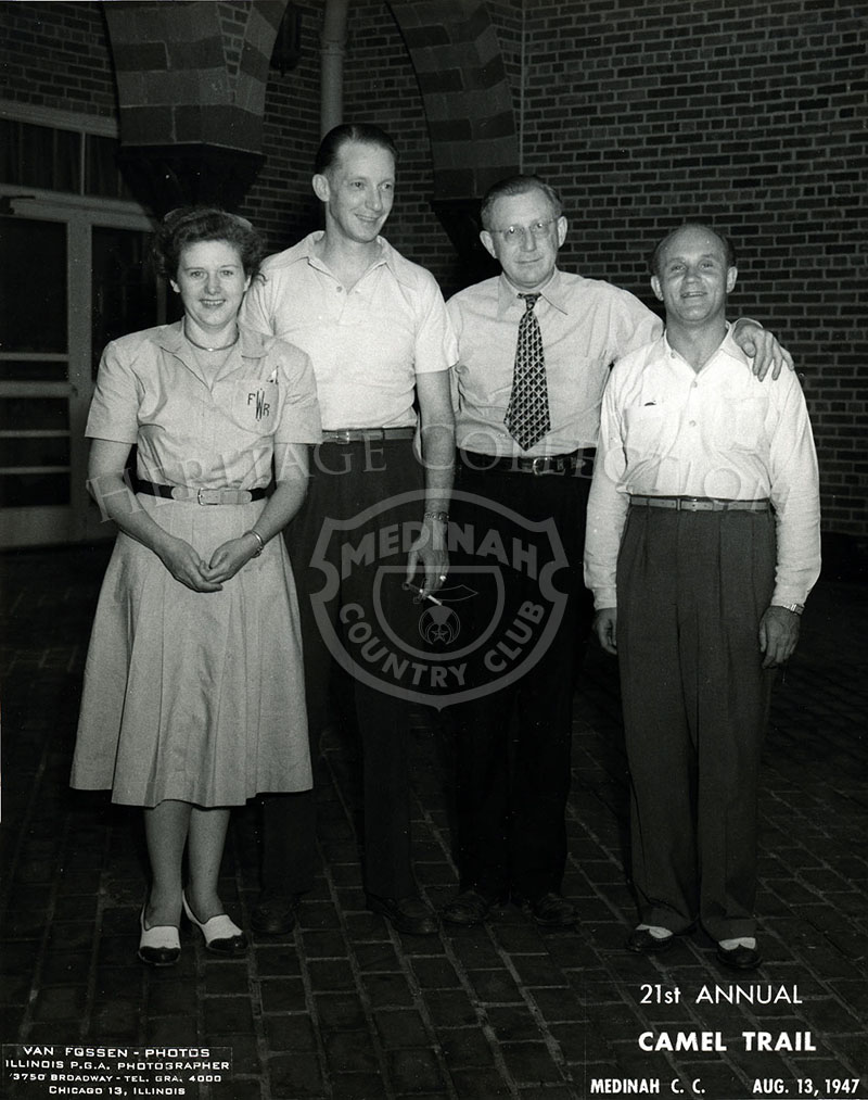 Photo shot during the 1947 Camel Trail, an annual men's golfing event. L-to-R includes Frieda Womeldorf, club general manager Wally Womeldorf, assistant manager Mr. Fredriksen, and locker room superintendent Dick Allen.