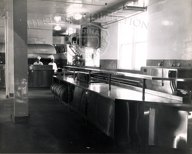 View of kitchen with two chefs in background, from April 14, 1949.