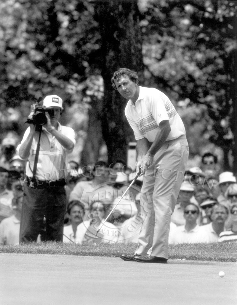 Hale Irwin watches over one of his putts during the playoff round of the 90th U.S. Open Championship. The 18-hole shootout was against challenger Mike Donald, and held on June 18, 1990.  After a tie on the playoff, Irwin, age 45, went on to birdie the 1st sudden death hole to give him his third Open title.