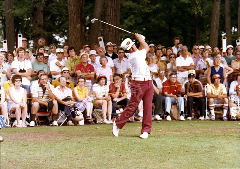 All eyes in the crowd follow through along with Lee Trevino's swing during the 75th U.S. Open Championship.