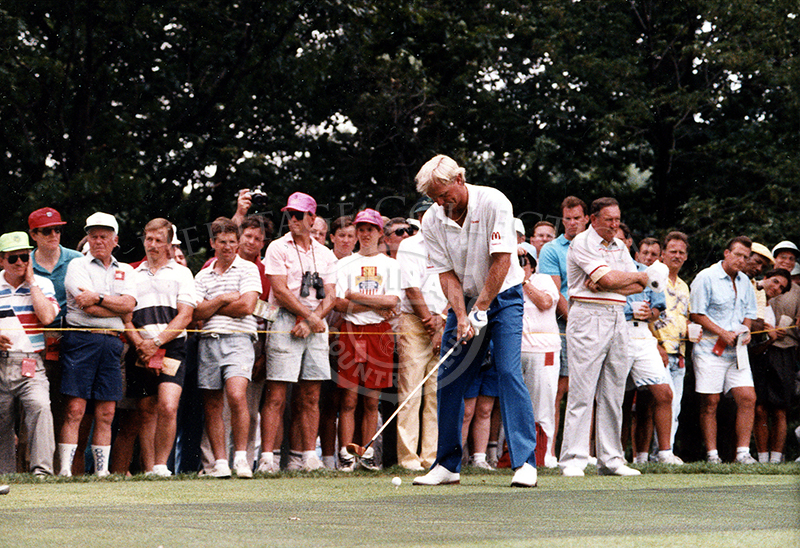 Using one of his fairway woods, Greg Norman is photographed in action during the 90th U.S. Open championship at Medinah. Norman was quote that he was
