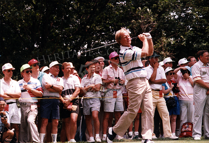 With a driver in hands, Jack Nicklaus shows good form as he blasts a ball down one of the fairways at the 90th U.S. Open championship. He finished the tournament with a total of 289, nine strokes behind winner Hale Irwin.