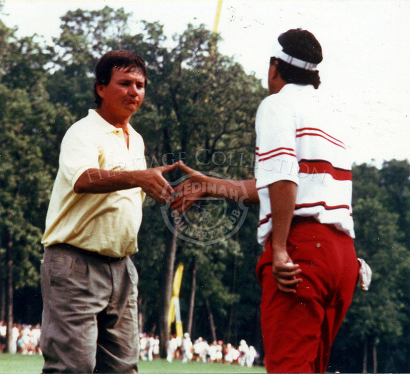 Mike Donald, facing camera, shakes hands with Billy Ray Brown during the 90th U.S. Open. Donald went on to the playoff round against Hale Irwin, and finished in second place at the conclusion of the tournament. Brown tied for 3rd place with Nick Faldo.