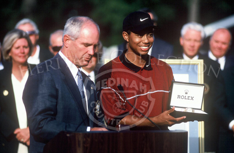 Tiger Woods and trophy.