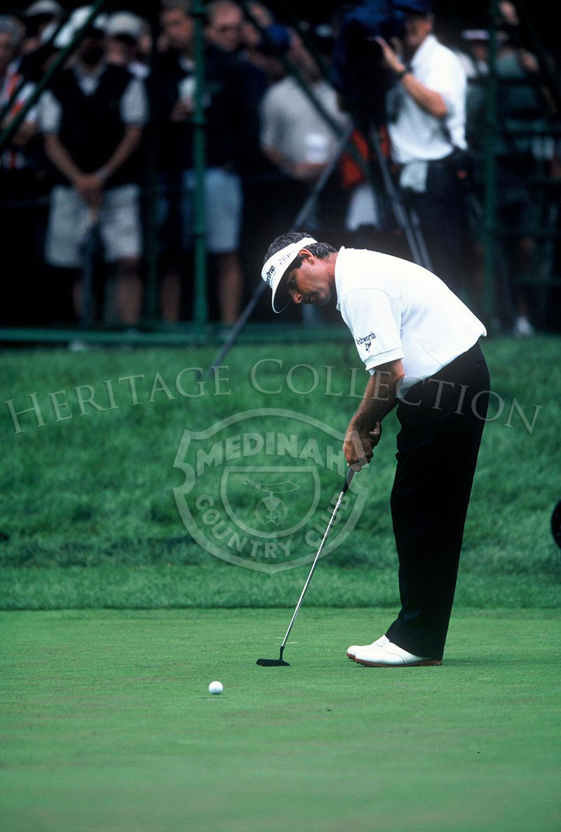 Fred Couples carefully lines up a putt during the 81st PGA championship. He was paired with Nick Faldo for Round 4, and finished the tournament with a 289. This tied him with four others for 26th-place.