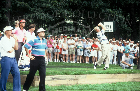 Jack Nicklaus uses an iron to tee off from Hole 2 of Course No. 3. On the far left, in blue, white and pink striped shirt, is Raymond Floyd.