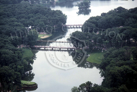 Aerial view shows three of the four bridges that cross Lake Kadijah on Medinah Country Club's Course No. 3. The bridge in the foreground leads to the 14th fairway, while the middle bridge takes you to the 13th hole green. Third bridge in the background is