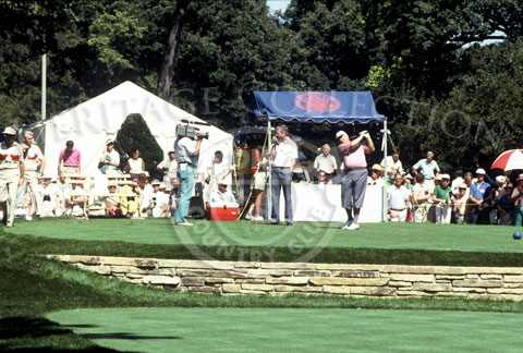 Unfazed by the gallery behind him and other activities nearby, Billy Casper practiced his swings before one of the 18-rounds of the Ninth U.S. Senior Open Championship. He eventually finished the tournament in 10th place, tying with Butch Baird.