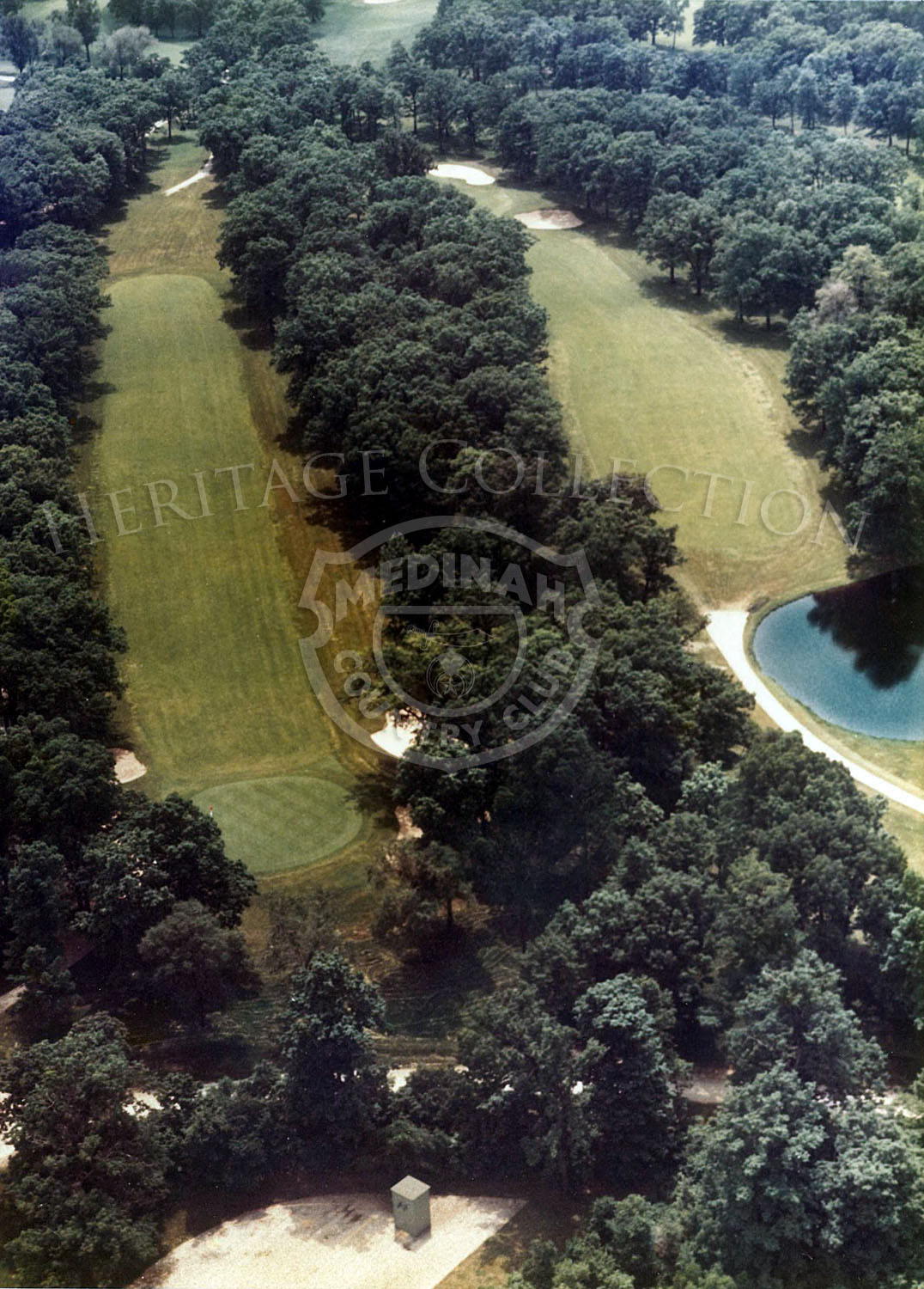 1975 Aerial view of Hole 4 of Course No. 3. It is a testing par-4 of 446 yards tree-lined from tee to elevated green