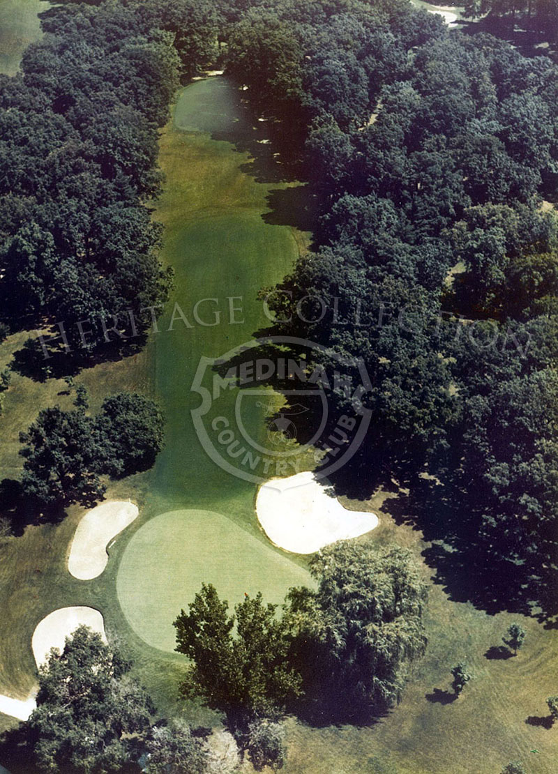 1975 Aerial view of Hole 8 of Course No. 3. The 205-yard par-3 eighth is deceptive. Trees shield the player from the wind which can fool the airborne shot. The green, supposedly flat, has many subtle rolls.