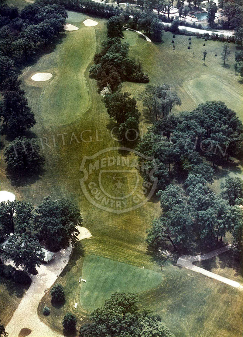1975 Aerial view of Hole 12 of Course No. 3. Premium is on accuracy off the tee on the 384-par-4 twelfth. Any tee-shot left of center will be blocked from the access to the pin if set on the left of the green.