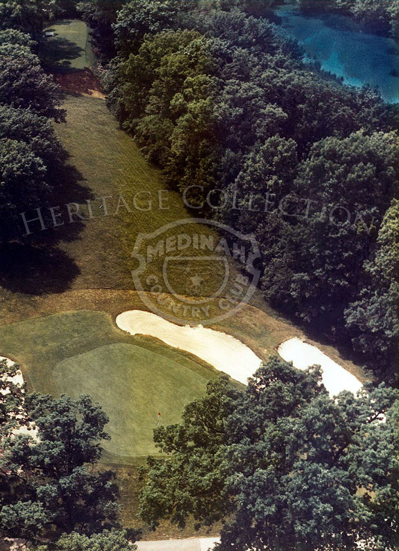 1975 Aerial view of Hole 14 of Course No. 3. This short par-3 of 167 yards fourteenth should provide its quota of birdies, but plenty of trouble lurks for those who pull or overshoot the green.