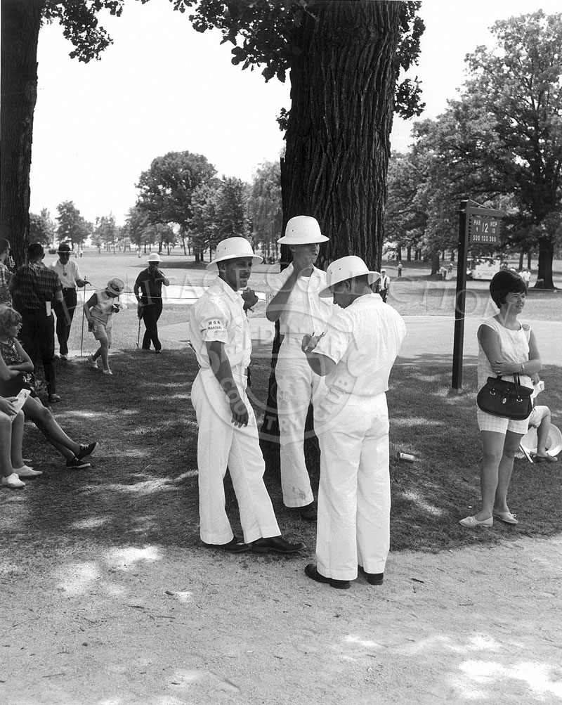 Three men, all dressed in white, served as WGA Marshalls during the 63rd Western Open in 1966.