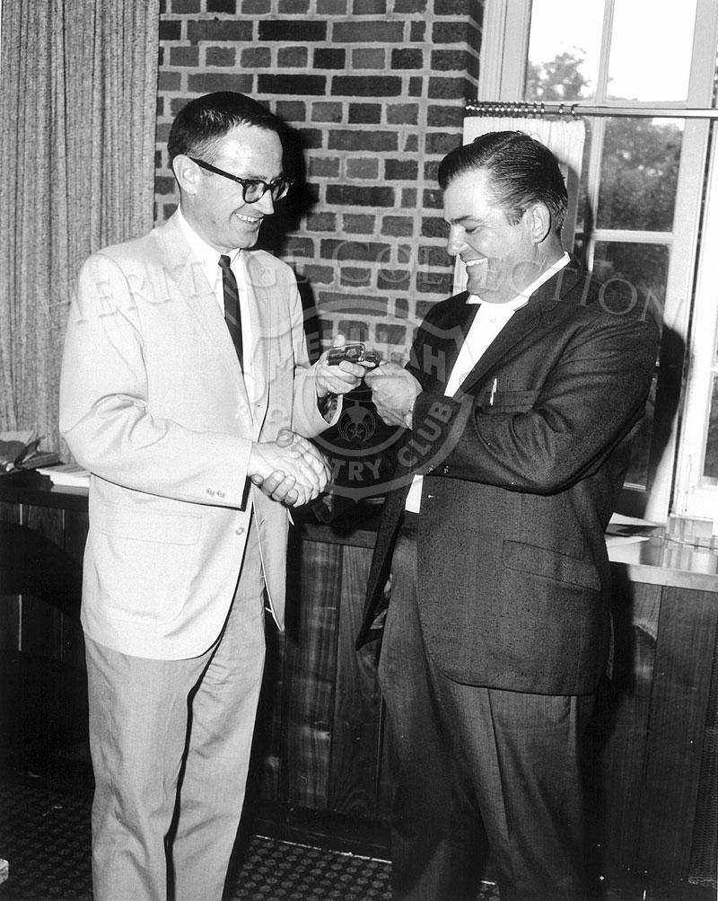 Unidentified gentleman on right receives keys to a 1966 Plymouth Fury II Silver Special four-door sedan after hitting a hole-in-one at Medinah Country Club.