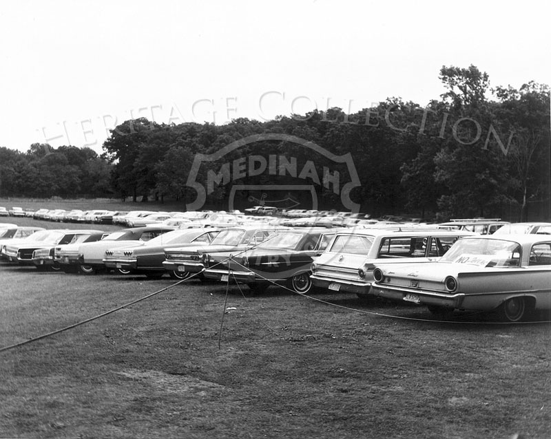 All 1960s era automobiles are pictured in a photo from one of the public parking lots around Medinah Country Club during the 63rd Western Open.