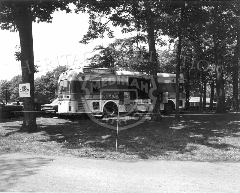 Parked on Medinah Country Club grounds during the 63rd Western Open, was an Illinois Bell Telephone Co. bus. The large bus offered several