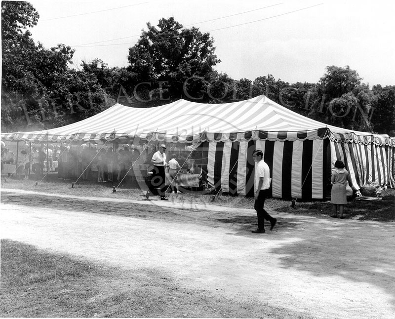 Smoke emanating from one of the large refreshment tents, indicates that hot dogs and hamburgers were being cooked and served to the hungry crowds who attended the 63rd Western Open tournament in 1966.