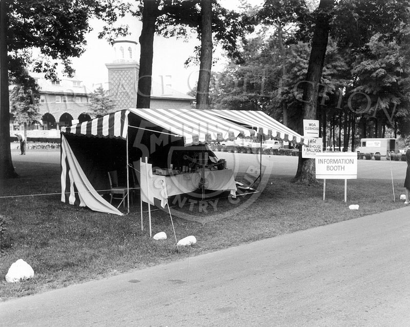 One of the Information Booths used during the 63rd Western Open tournament in 1966, was located near the front entrance to Medinah's club house. A portion of the legendary building, including the South Tower, can be seen in the background.