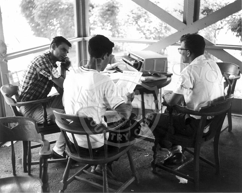 Three men with WGA issued armbands are involved with detailed reports during the 63rd Western Open tournament in 1966.