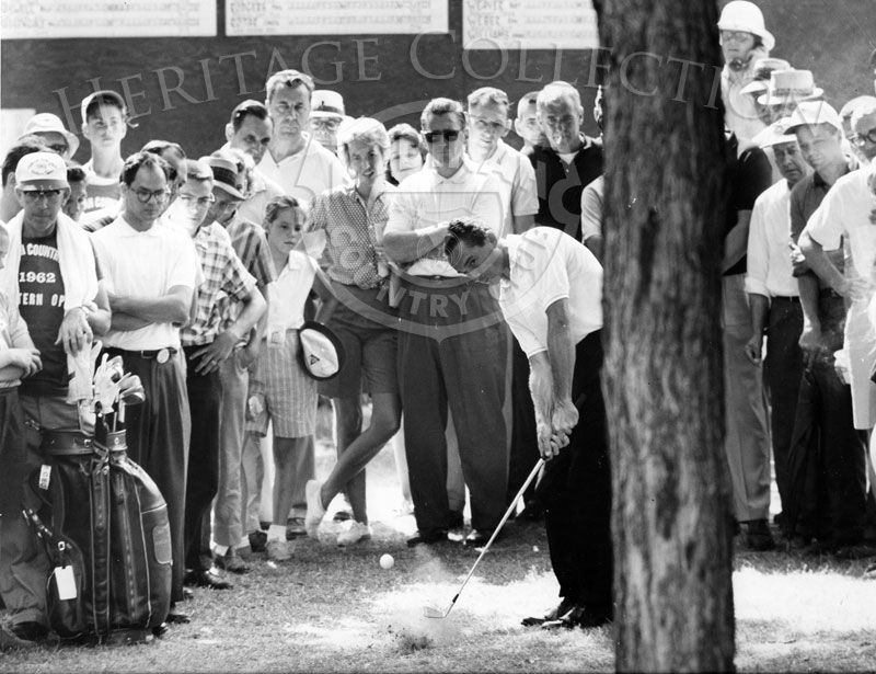 Professional golfer Dow Finsterwald had a tough shot from behind a tree during the 59th Western Open in 1962. He tied for 8th place at the conclusion of the tournament with a 291, seven strokes over par.