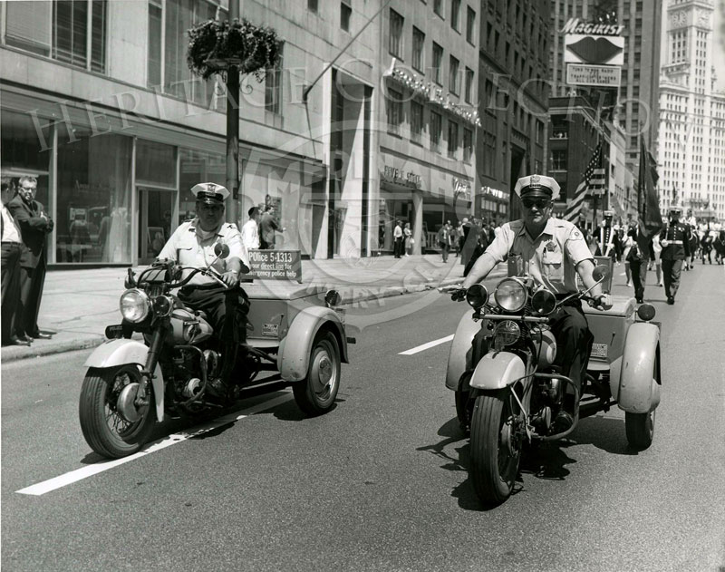 Chicago motorcycle policemen escorted the 1962 parade promoting the 59th Western Open at Medinah Country Club. The parade started on Wacker Drive, and as pictured in this scene, continued south on Michigan Ave.