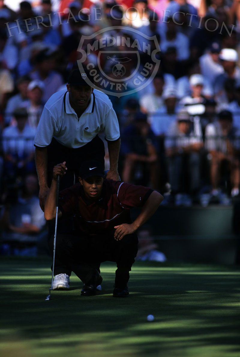 Round 4: Tiger Woods and caddie . Photographer: Montana Pritchard