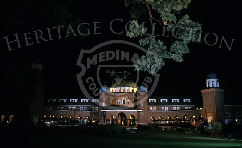 Night photo of Medinah club house, after Round 3. Photographer: Montana Pritchard